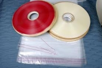 Flip top with adhesive tape polybags